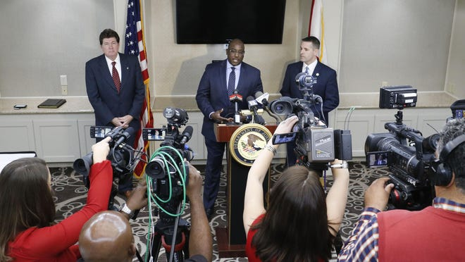 Alabama's three U.S. attorneys announce increased federal involvement in the shootings of police officers Friday, Feb. 1, 2019, at Hotel Capstone. Louis V. Franklin Sr., U.S. attorney for Alabama's middle district, speaks at  the news conference, flanked by southern district attorney Richard W. Moore, left, and northern district attorney Jay E. Town.
