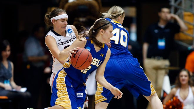 South Dakota State's Macy Miller goes around a screen set by teammate Mariah Clarin (right)  during the first half of a women's college basketball game in the first round of the NCAA tournament in Corvallis, Ore., on Friday, March 20, 2015. (AP Photo/Timothy J. Gonzalez)