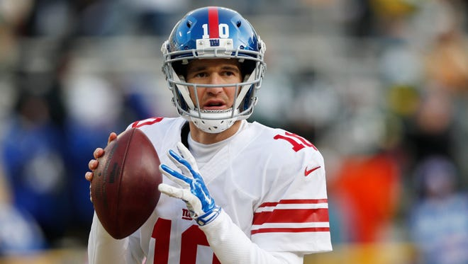 New York Giants quarterback Eli Manning (10) before the NFC Wild Card playoff football game against the Green Bay Packers at Lambeau Field.