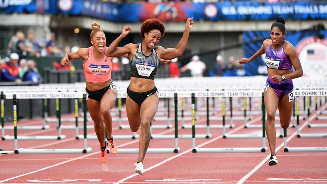 zJul 8, 2016; Eugene, OR, USA; Brianna Rollins (center) and Kristi Castlin (right) and Queen Harrison (left) finish first, second, and fourth respectively in the 100m women's hurdles in the 2016 U.S. Olympic track and field team trials at Hayward Field. Mandatory Credit: James Lang-USA TODAY Sports