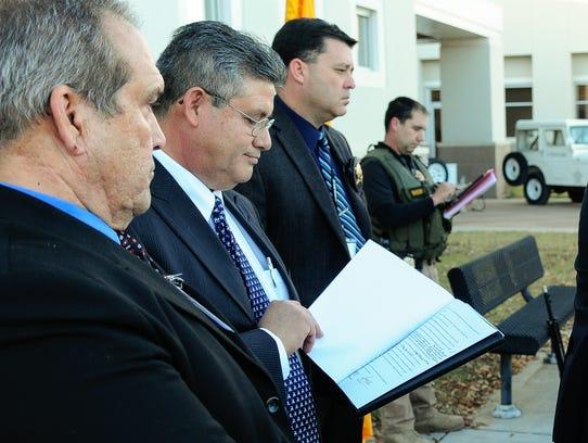 District Attorney Mark D'Antonio speaks `while Sheriff