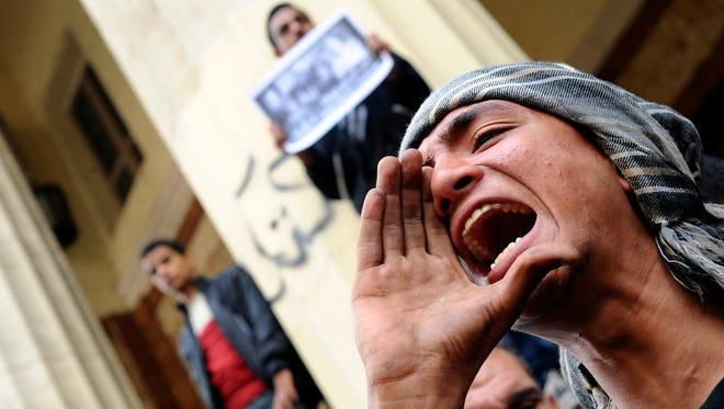A protester chants slogans near a Cairo court.