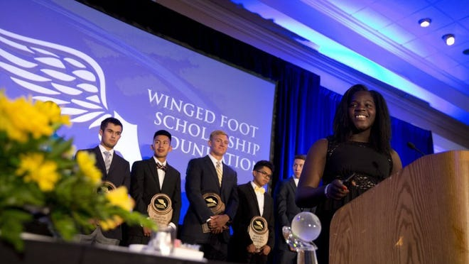 Winner of the 2016 Winged Foot Scholar-Athlete Award Stephanie Paul, center, smiles while giving her acceptance speech Thursday at the Naples Grande Beach Resort in Naples. Paul finished with a 3.62 GPA, lettered in basketball and track, and will be playing Division I basketball for the University of Georgia.