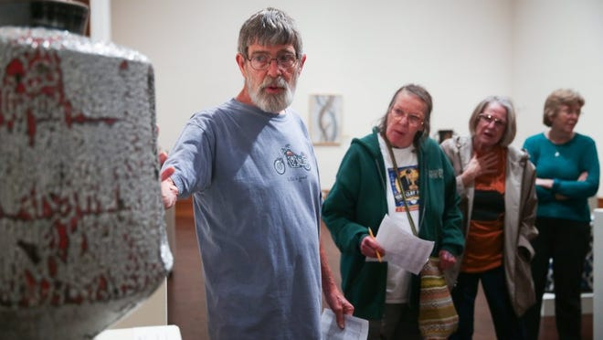 Visitors listen to Roger Allen talk about technique during the National Ceramic Competition at the San Angelo Museum of Fine Arts in 2016.