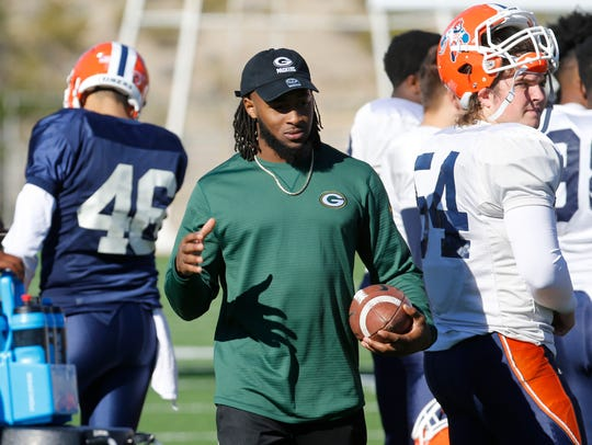Former UTEP Miner Aaron Jones, now a Green Bay Packers running back, walks the sidelines during a UTEP practice Wednesday morning.