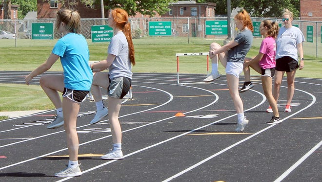 Kewanee High School girls volleyball coach Claire Nichols conducts outdoors conditioning with students on Tuesday at Kewanee Stadium. Weight training and conditioning with in groups of 10 or fewer people are allowed under the current Stage 1 return-to-play guide. The Illinois High School Association released a draft version of Stage 2 that it has submitted to the Illinois Department of Health for approval.