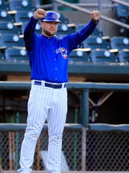 Iowa Cubs hitting coach Chris Valaika works the third