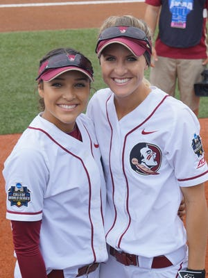 Former Pensacola prep softball stars Korina Rosario (left) and Victoria East, shown prior to the game, saw action Thursday in Florida State's 5-4 loss to Georgia in the  Women's College World Series in Oklahoma City.