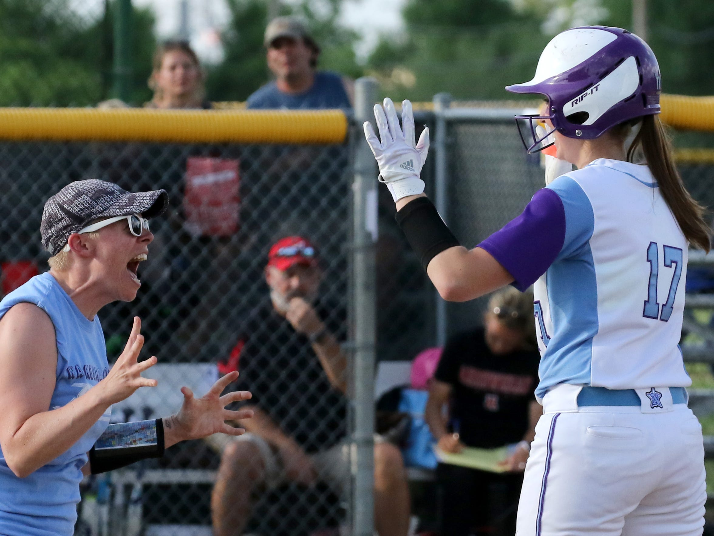 Waukesha North's Haley Marking is congratulated by