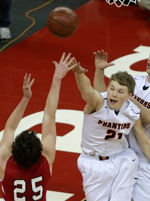 West De Pere's Connor Konshak (left) and Cody Schwartz defend Mount Horeb's Max Meylor during Friday's WIAA Division 2 boys' state basketball tournament at the Kohl Center in Madison.
