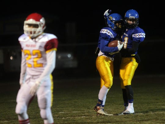 Serrano's Sultaan Sullivan celebrates his touchdown in the first quarter with teammate Tanner Cornell as Palm Desert's Darrian Lasarte walks away on Friday during the CIF Eastern Division semifinals played in Phelan, CA.