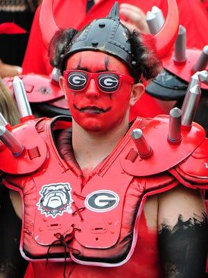 A Georgia fan watches the Bulldogs fall to Vanderbilt.