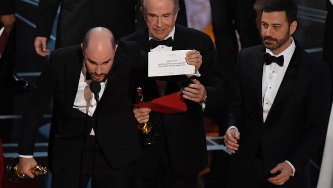 """La La Land"" producer Jordan Horowitz shows the card saying ""Moonlight"" won the best picture."