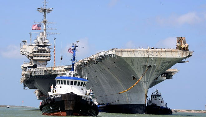 The decommissioned USS Independence is towed on its final voyage to the Port of Brownsville near Port Isabel, Texas, on June 1.