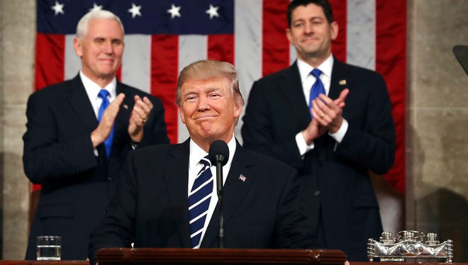 In this Feb. 28, 2017, photo, President Donald Trump, flanked by Vice President Mike Pence and House Speaker Paul Ryan of Wis., arrives on Capitol Hill in Washington, for his address to a joint session of Congress.