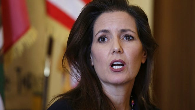 In this June 15, 2016, file photo Oakland Mayor Libby Schaaf answers questions during a news conference at City Hall in Oakland, Calif. Schaaf warned over the weekend of Feb, 24, 2018, that federal agents were planning immigration raids across the San Francisco Bay Area.