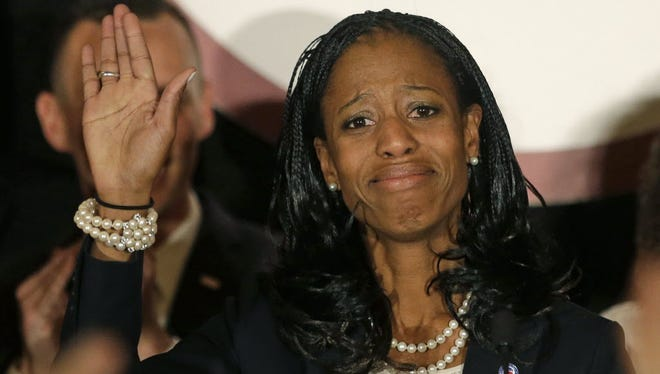 Mia Love becomes emotional as she speaks with supporters.