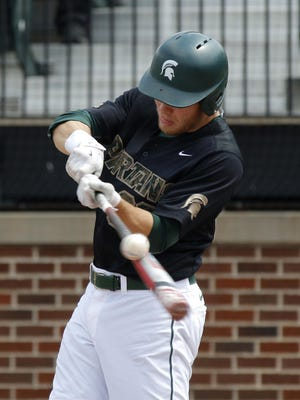 Michigan State's Brandon Hughes, shown during a game last season, hit three of his team's eight home runs in the Spartans' 17-6 win over Illinois on Sunday. MSU (15-5) hit 13 home runs on the weekend in a three-game sweep of the Illini.