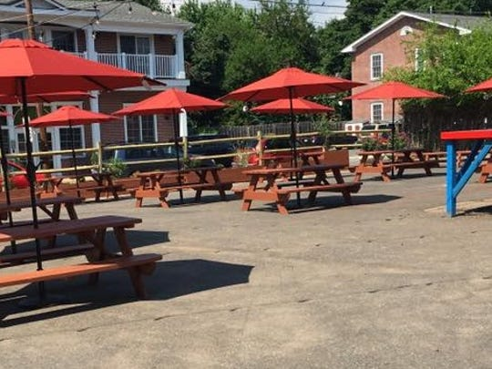 The abandoned gas station on Flemington's Main Street, the site of the popular summer beer garden, has been sold for $220,000.