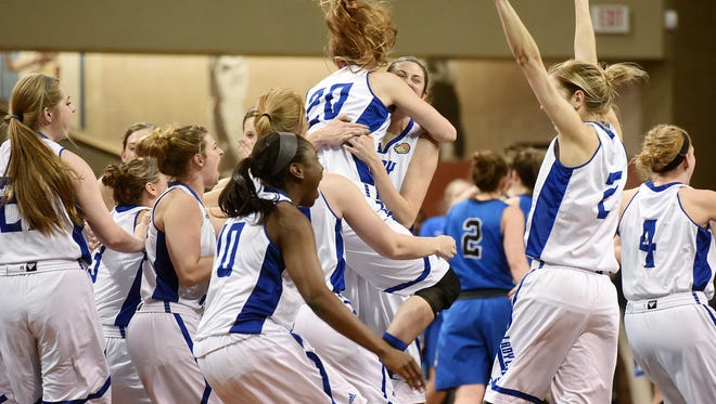 Lubbock Christian University celebrate their win against Bentley University at the Sanford Pentagon in the semifinals of the 2016 NCAA Division II Women's Basketball Championship on Wed., March 23, 2016.