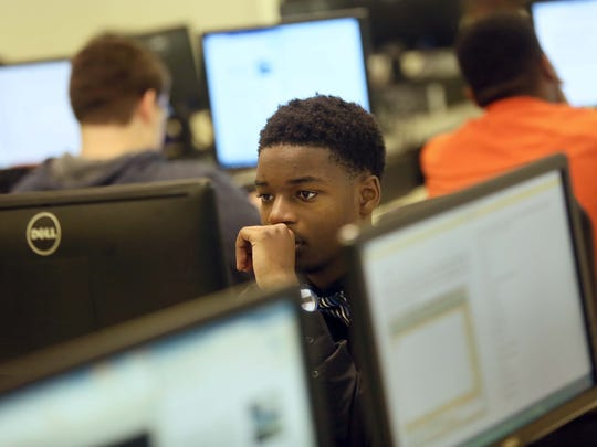 """15 year-old Nazir Johnson, a sophomore at Hodgson Vo-Tech High School, works on learning how to create networks during computer software class. On Monday, Gov. Jack Markell announced in Johnson's class that the state is going to more than double the size of its Pathways to Prosperity program. The program puts high school students on """"pathways"""" that make sure they get the right courses and give job shadowing and internship programs."""