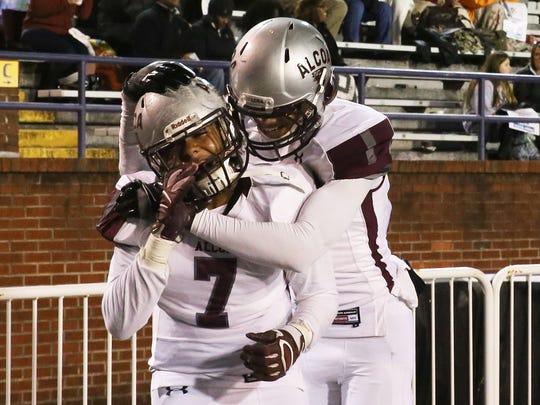 Alcoa's Johntazzie Montague, right, hugs Dontae Walden