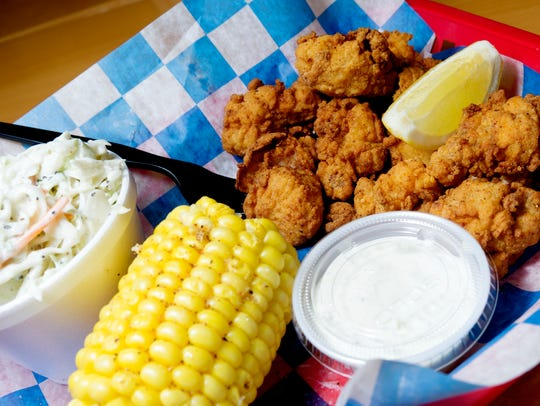 "The ""Gator Bites"" food basket features sides like coleslaw and corn at The Shrimp Dock on Kingston Pike in Knoxville."