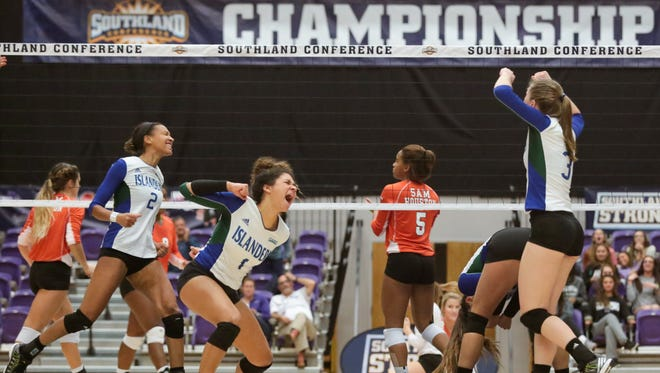 Texas A&M-Corpus Christi celebrates after the match-clinching point against Sam Houston State in the Southland Conference Tournament championship match. The Islanders will travel to Seattle to take on 8 seed Washington in the NCAA Tournament on Friday.