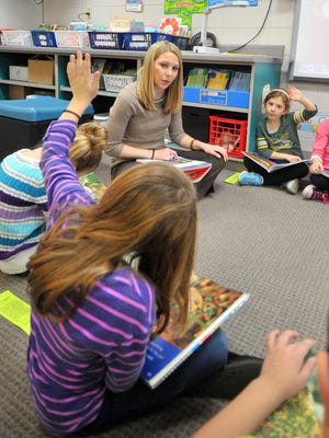 Second grade teacher Brittany Hoffa, middle, works with her class during a reading discussion Tuesday at Auburndale Elementary School.