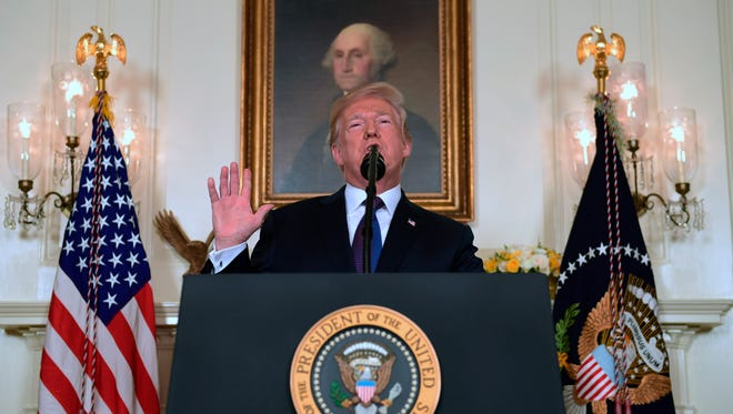 President Donald Trump speaks in the Diplomatic Reception Room of the White House on Friday, April 13, 2018, in Washington, about the United States' military response to Syria's chemical weapon attack on April 7.