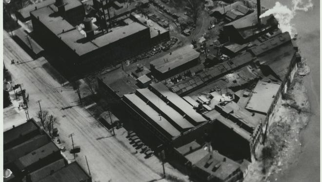 This aerial view, looking southeast from above the State Street Bridge, shows the maze of buildings in the huge Herbrand works about 1930.