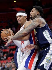 Pistons forward Tobias Harris, left, defended by Nuggets forward Wilson Chandler, right, looks to pass the ball during the first half on Tuesday, Dec. 12, 2017, at Little Caesars Arena.