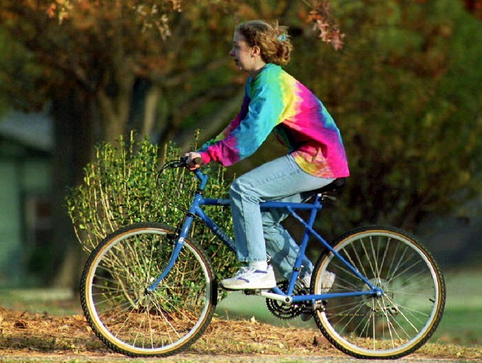 LITTLE ROCK, UNITED STATES:  Chelsea Clinton, daughter of U.S. President- elect Bill Clinton, rides a bicycle 14 November, 1992, on the grounds of the Governor's mansion. The Clintons will host a dinner for Democratic Senate and House majority leaders 15 November, 1992 at the mansion.