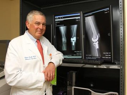Dr. Robert Small, photographed in his office on Aug. 28, 2013.