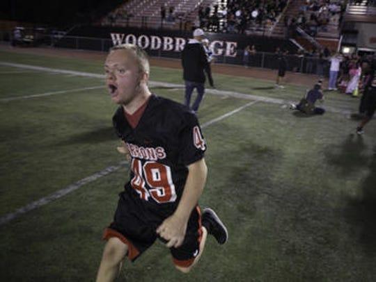 Patrick Petro leads the Woodbridge High School football