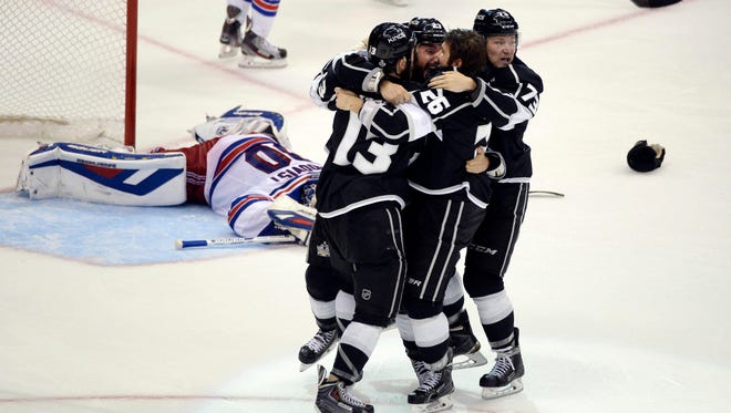 The Los Angeles Kings celebrate Alec Martinez's winning goal against the New York Rangers.