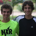 St. Xavier High School's returning cross country starters Chris Reischel, left, and Austin Angeline practiced Sept. 2.