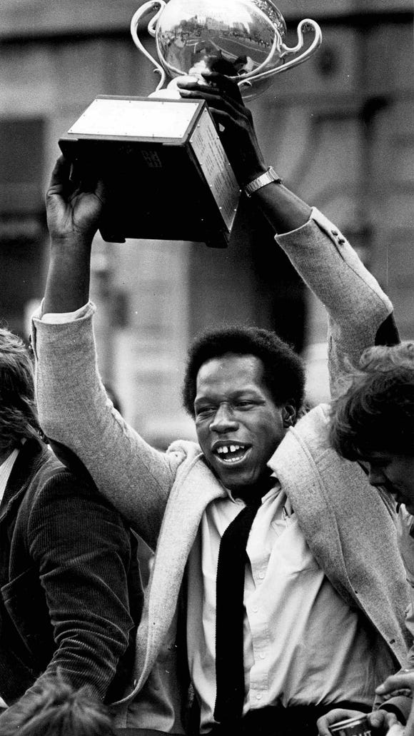 A jubilant Val James shows off the Calder Cup during the Amerks championship parade through downtown in  May of 1983.