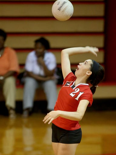 Leon's Hannah Rodriguez leaps on a serve as the Leon Lions cruise past the Godby Cougars in 3 straight sets on Tuesday night at Leon High.