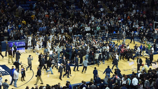 Penn State Nittany Lions fans storm the court following the game against the Iowa Hawkeyes at the Bryce Jordan Center.  The Nittany Lions won 79-75.