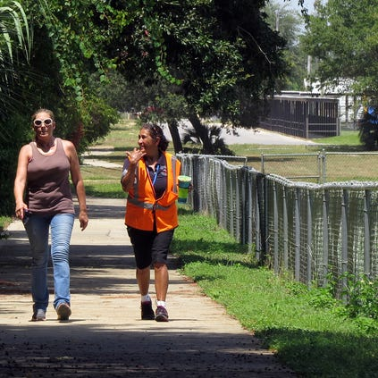 A couple of Santa Rosa school bus drivers use Ladner Lane behind the Gulf Breeze High, middle and elementary schools to get a bit of exercise after eating lunch in their buses as they wait to bring Gulf Breeze Middle school students home from school Wednesday afternoon.  Gulf Breeze school officials are asking residentswho use the nature trail — which runs behind the three schools — not to leave the trail to cut across campuses between 7 a.m. and 4 p.m.