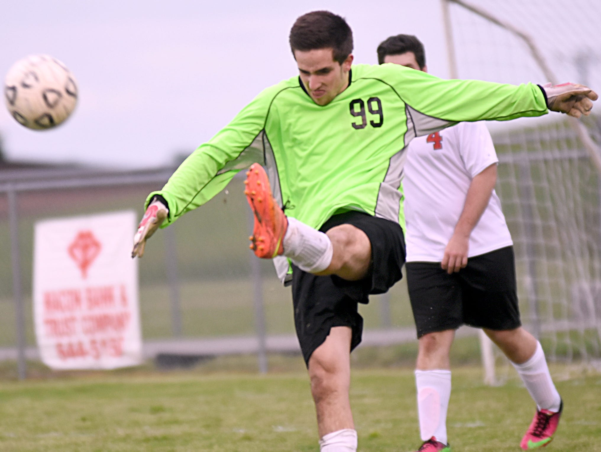 Westmoreland High senior goalkeeper Lukas Carter punts during first-half action.
