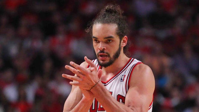 Chicago Bulls center Joakim Noah (13) celebrates scoring during the second quarter of game one of the first round of the 2014 NBA Playoffs against the Washington Wizards at the United Center.