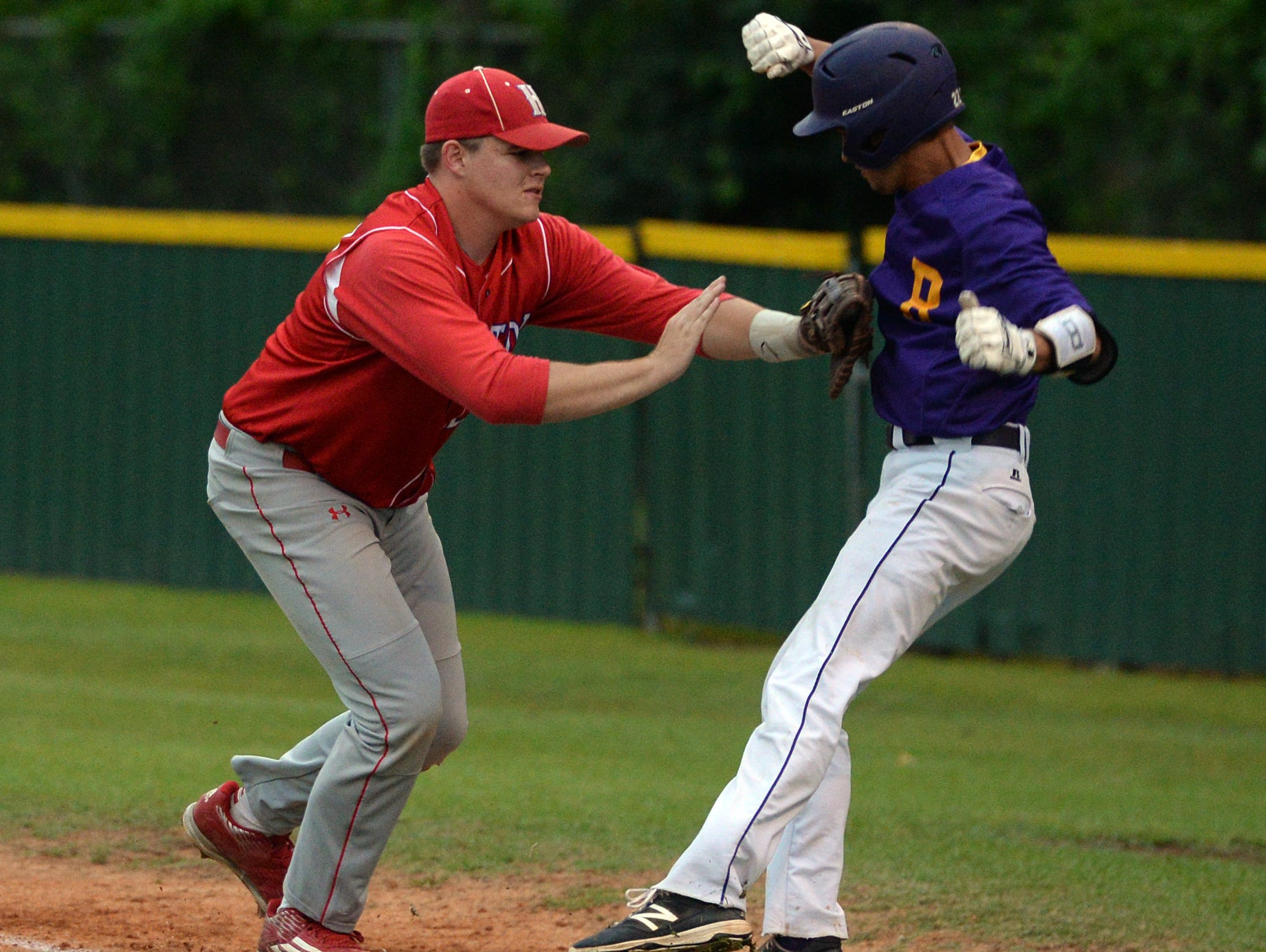 Haughton first baseman Brennan Bockhaus tags out Wyate Brooome to end the 4th inning.