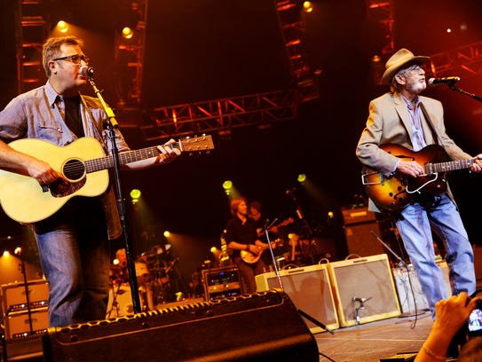 Vince Gill, left, performs with Don Williams during