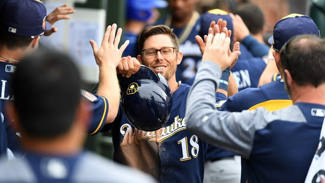 Eric Sogard celebrates with teammates in the dugout after scoring on a double by Hernan Perez during the fifth inning of a spring training game against the Kansas City Royals at Surprise Stadium on Wednesday.