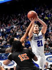 Covington Catholic's A.J. Mayer (21) pushes a jumps