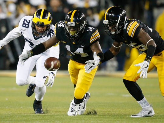 Iowa cornerback Desmond King bobbles the ball but is