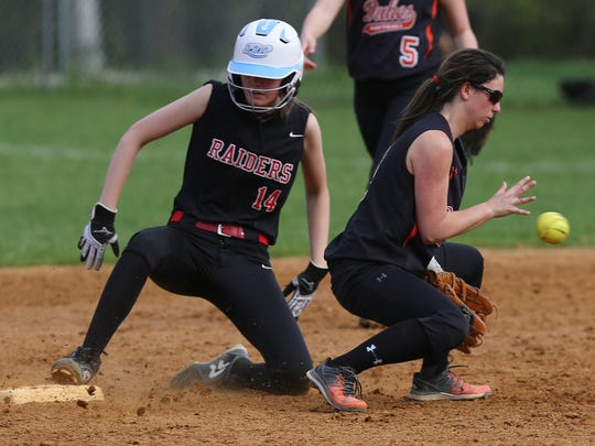 From left, Red Hook's Alyssa Rusnock (14) slides safe into second with a double as Marlboro's Taylor Felicello (9) takes the relay during girls softball action at Recreation Park in Red Hook April 28,  2017. Marlboro won the game.
