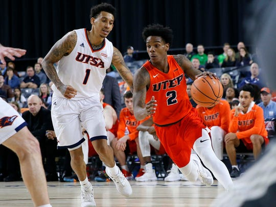 Omega Harris tries to drive by a defender in UTEP's game against UTSA in the first round of the Conference USA Tournament. The Miners were eliminated.